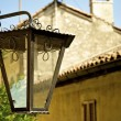Stock Photo: Lamp post in front of house of town on mountain hill called Gandria, Switzerland
