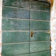 Stock Photo: Door on the house of the town situated on the mountain hill called Gandria, Switzerland