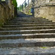 Stock Photo: Stone stair way in the town on the mountain hill called Gandria, Switzerland