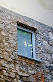 Window on house of the town on the mountain hill called Gandria, Switzerland — Stock Photo