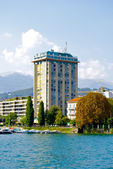 Beautiful view from the lake on the building of Lugano — Stock Photo
