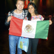 Girl and boy from Mexico with the national flag — Stock Photo