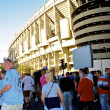 Fans near the Santiago Bernabeu stadium - Stock Photo
