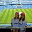 Two girls supporting Real Madrid - Stock Photo