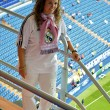 Girl in Real Madrid shirt - Stock Photo