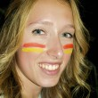 Stock Photo: Beautiful girl with Spanish flag sign on the face