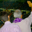 Father and son watch football - Stock Photo