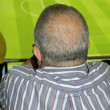 Bald supporter watches the game attentively - Stock Photo