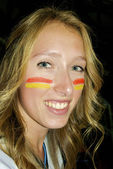 Beautiful girl with Spanish flag sign on the face — Stock Photo