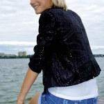 Nice blond caucasian model girl poses on the pier — Stock Photo