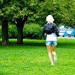 Girl runs on the grass — Stock Photo #13158611