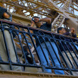 Taking photos on the Eiffel Tower — Stockfoto