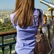 Beautiful girl on the Eiffel tower - ストック写真