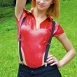 Beautiful sexual girl poses wearing red and black — Stock Photo #13260904