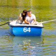 Couple in love in the boat over the lake — Stock Photo