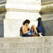 Half naked man takes a rest near the monument — Stock Photo