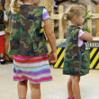 Stock Photo: Cute little girls in camouflage