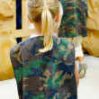 Cute little girl in camouflage — Stock Photo