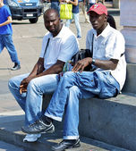 Two African men sit — Stock Photo