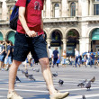 Man and pigeons — Stock Photo