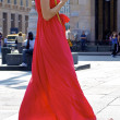 Woman in a red dress — Stockfoto
