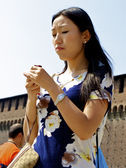 Asian girl with a phone — Stock Photo