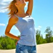 Sexy blond girl poses in a desert — Stock Photo #13477425