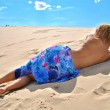 Half naked girl lays on the sand — Stock Photo