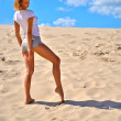 Alone sexy blond girl poses in the desert — Stock Photo
