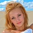 Sexual blond girl on the sand — Stock Photo