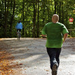 Man does jogging in a park - Stock Photo