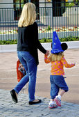 Mother and daughter in a Disney hat — Stock Photo