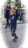 Happy boy with raises hands — Stock Photo
