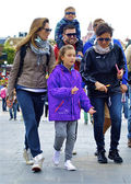 Family in the sun glasses go to the Disneyland — Stock Photo