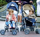 Brother and sister in pram — Stock Photo