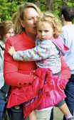 Mother hugs her daughter — Stock Photo
