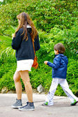 Mother and son walk in the Disneyland — Stockfoto