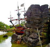 Pirate ship behind the rock — Stock Photo
