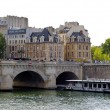 Royalty-Free Stock Photo: Tourist boat near the Pont Neuf. New bridge in Paris, France