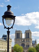 Lamp post and Notre Dame de Paris — Stock Photo