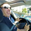 Happy man drives and poses — Stock Photo #13593555