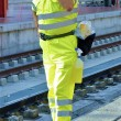 Station worker talks on cellular — Stock Photo #13593995