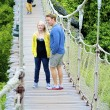 Stock Photo: Couple on rope bridge