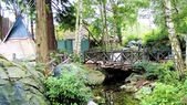 Wooden bridge and wigwam — Stock Photo