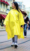 Girl in a yellow coat — Stock Photo