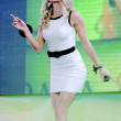 Blond contestant girl in white sexual dress sing and dances — Stock Photo #13708849