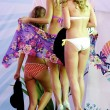 All contestants walk away after bikini contest of show — Stock Photo #13709423