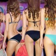 Three contestant girls poses in bikini fron behind — Stock Photo #13709445