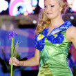 Amazing blonde contestant walks over runway in green dress — Stock Photo #13709942