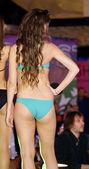 Beautiful girls poses in blue bikini — Stock Photo